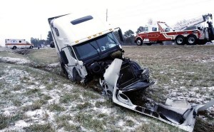 The Chevy HHR crashed into the front of a 2002 Freightliner tractor trailer truck that was traveling south on US 43