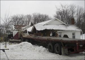 The tractor trailer truck went off the highway on the east shoulder and crashed into a single story home and a parked vehicle at 10758 State Route 23.