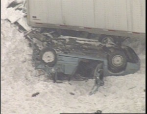 The tractor trailer jack-knifed and slammed into a Buick Regal car that was parked on the side of the interstate.