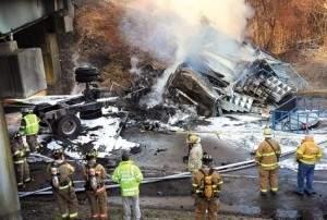The fire from the truck accident burned fast and trapped the driver in the fiery cab of the semi. In less than a half hour both parts of the tractor trailer truck were pieces of charred, smoldering wreckage.