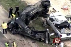 Three pickup trucks lie entangled in a twisted pile of wreckage following the horrific truck accident in Bulverde, Texas on Highway 46 just west of U.S. 281.