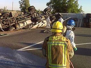California Highway Patrol responded to the scene of the truck accident and cordoned off the area around the overturned 18 wheeler and the spilled hazardous material on the highway.