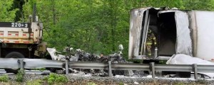 The semi trailer truck and the DOT truck ended up against the highway guardrail.