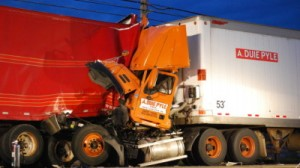 The impact of the truck accident caused damage to the back trailer of the front semi truck and crushed the cab of the second truck which bore the logo of A. Duie Pyle, a transportation company based in West Chester, PA.