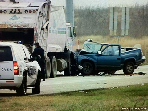 One person was killed when a garbage truck collided with a blue pickup truck on the State Highway 130 service road near Austin, TX on February 22, 2013. Photo credit: Chris Nelson / KXAN