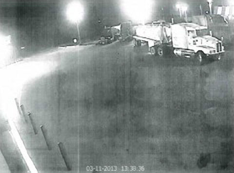 Surveillance camera image of a white Kenworth semi truck with vacuum tanker trailer that pulled out onto Texas Highway 44 and struck Luis David Wiles on March 12, 2013. Wiles was riding on a bicycle on the shoulder of the road at the time and suffered a broken leg in the accident. Photo credit ofelia.hunter@aliceechonews.com