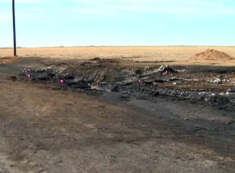 Roadside with charred remains where five teens were killed in a fiery crash with a gasoline tanker truck in Dumas, TX on March 10, 2013.