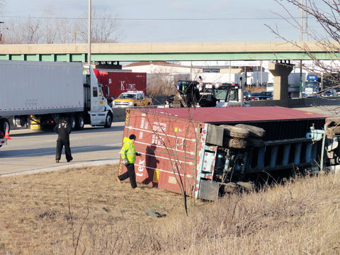 On March 19, 2013 a semi truck rolled over into a ditch after crashing with a passenger vehicle on the westbound I-80 in Frankfort, IL Photo credit: Nick Swedberg