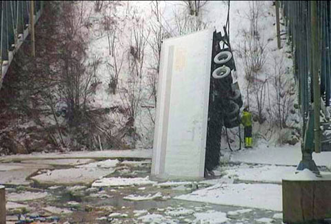 A trucker was killed when his semi truck plunged into the Red Cedar River off the westbound I-94 in Menomonie, WI on March 5, 2013 in snow covered conditions. Photo credit: WEAU-TV