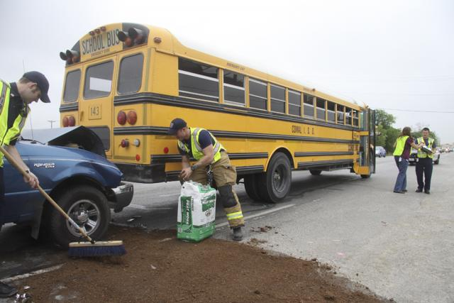 Photo shows School bus rear eded by a pickup truck on April 17, 2013.