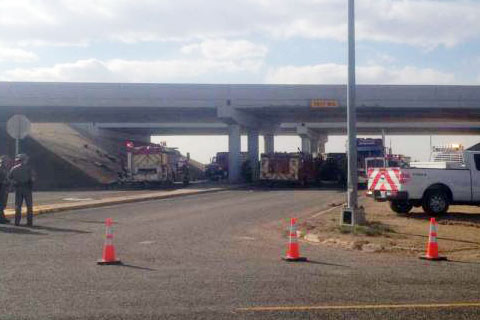 A southbound tractor trailer hauling batteries on I-27 drove off an overpass and landed on the roadway below in New Deal, TX about 12 miles north of Lubbock. Photo credit: Avalanche-Journal