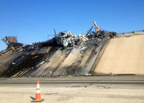 Charred wreckage of two semi trucks after a fiery fatal collision with an SUV going the wrong way on I-20 between Penwell and Odessa, TX on April 4, 2013. Photo credit: Tom Michael / KXWT