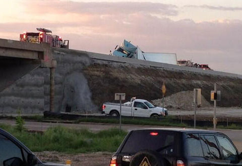 A semi truck rolled over on U.S. Highway 75 near University Dr. in McKinney, TX spilling 50,000 lbs of cake mix and holding up traffic for hours on April 25, 2013. Photo credit: Keaton Fox, NBC 5