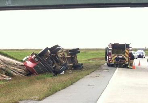 A log truck driver was killed when his tractor trailer lost control and went off the road while negotiating a curve at an exit on I-530 in Pine Bluff, AR on April 26, 2013. Photo credit David Goins / Fox16.com