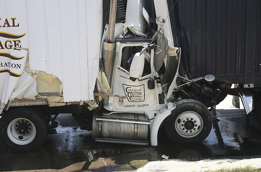 Photo shows damage to tractor trailer after to semi trucks collided on May 8, 2013 in Cecil Georgia.