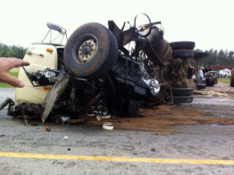 Two people were hospitalized after a semi truck smacked into the rear of a cement truck on the eastbound side of U.S. Highway 412 in West Siloam Springs, OK just inside the Arkansas/Oklahoma border on May 6, 2013. The tractor trailer was completely demolished.