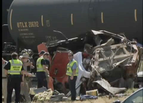 A semi truck driver was killed when his big rig was hit by a Union Pacific train after getting stuck on the tracks in Midland, TX on June 3, 2013.