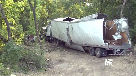A semi truck driver fell asleep at the wheel on the southbound I-75 and ran off the road into a creek in in Sherman, TX on September 5, 2013.