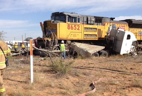 A semi truck got stuck at a rail crossing in Midland, TX and crashed with a Union Pacific train on October 10, 2013. Photo credit: CBS 7 News.