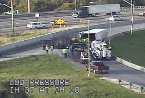A semi truck crashed at the I-37 interchange with U.S. Highway 90 / I-10 East spilling a load of limes and blocking traffic for hours in San Antonio, TX on October 3, 2013. Photo credit: Transguide.