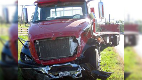 A semi truck collided with a passenger car in Montgomery, TX on October 24, 2013. Photo credit: Russell Ledbetter / The Courier