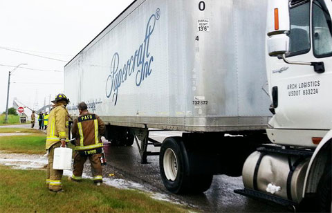 .A semi truck jacknifed on State Highway 73 in Port Arthur, TX spilling diesel fuel and the closure of the Rainbow Bridge on October 31, 2013. Photo credit: Luke Mauldin/The Port Arthur News
